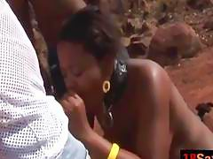 African babe pleasing two throbbing cocks outdoors